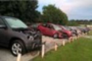 Woman dies after car crashes into 22 vehicles on garage forecourt