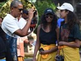 malia and sasha obama don colorful yellow sarongs in bali