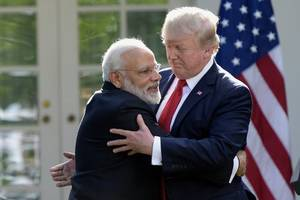 modi meets trump with his usual greeting - bear hugs