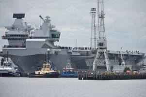 HMS Queen Elizabeth leaves Rosyth Dockyard as largest warship in British history