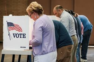 student sentenced to prison for or registering dead voters for democratic groups