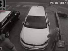 masked men swear at cctv camera before stealing cars