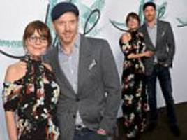 smitten damian lewis and helen mccrory cuddle up together