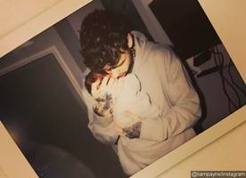 so cute! liam payne shares rare photo of him and son bear in matching yeezy trainers
