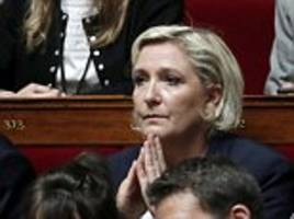 France's Marine Le Pen charged over EU funding scandal
