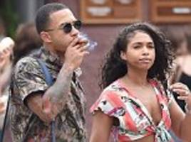 memphis depay puffs cigar on holiday with fiancee