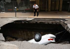 We Don't Know What Happened St. Louis Officials Clueless As Downtown Sinkhole Swallows Car