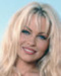 pamela anderson celebrates 50th birthday by flashing cleavage for playboy