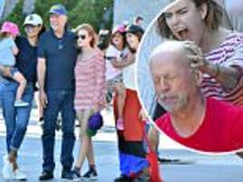 bruce willis swings by disneyland with wife and daughters