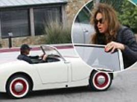 caitlyn jenner takes a spin in her vintage car in malibu