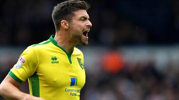 scotland defender martin extends norwich contract