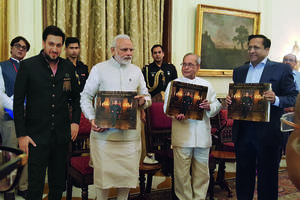 pm modi released coffee table book & presented the first copy to president of india on president pranab mukherjee - a statesman