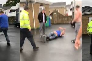 watch gangster robert kelbie kick opponent while he's on the ground during brutal fist fight in shocking video
