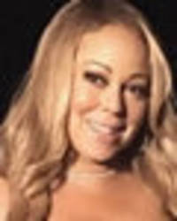 mariah carey flashes killer cleavage as she squeezes assets into wetsuit