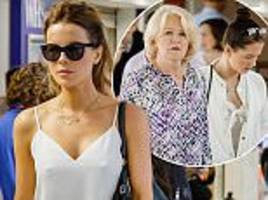 kate beckinsale joins daughter lily and mum at heathrow