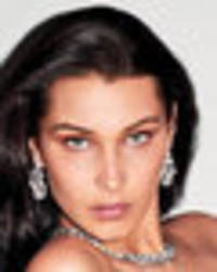 bella hadid serves breast appeal in completely topless exposé
