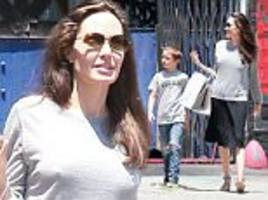 angelina jolie keeps it casual to toy store with son knox