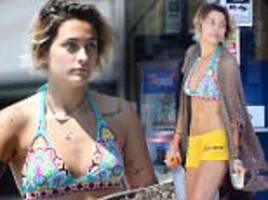 paris jackson shows off toned tummy in bikini top