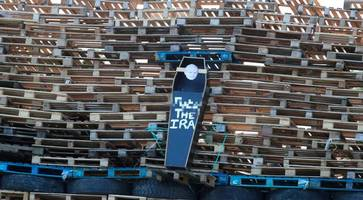 black coffin bearing martin mcguinness's face placed on northern ireland bonfire