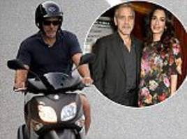 new dad george clooney spotted in lake como