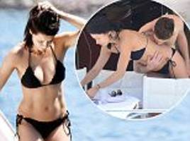 adriana lima takes to the water with metin hara in turkey