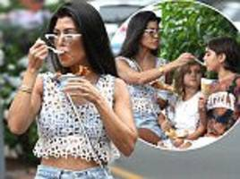 kourtney kardashian looks summery in white crochet top