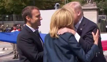 trump departs macron with excruciating 30 second handshake while kissing french president's wife