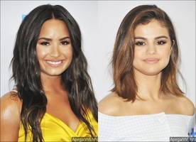 what feud? demi lovato and selena gomez fangirl over each other's music on twitter