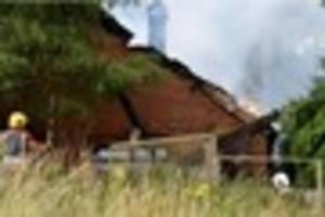 Watch as firefighters demolish a chimney with their hose at a...