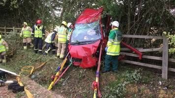 three women trapped and car left hanging after m40 crash