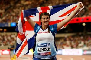 hollie arnold wins gold and improves her world record