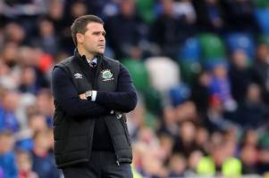 celtic are unlike any team i played against at rangers and will steamroll their way to another premiership title says linfield boss david healy