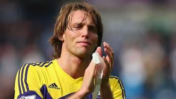 ex-swansea midfielder michu retires at 31