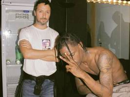 travis scott shows interest in buying nba team & then parties w/ one of its biggest stars [video]
