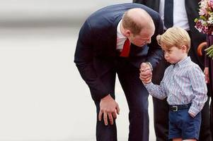 Prince George looks far from happy as he arrives in Poland for royal visit