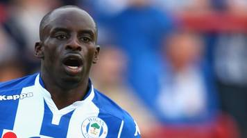 sanmi odelusi leaves wigan athletic by mutual consent