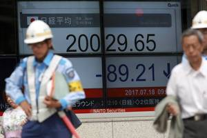 Asian shares mostly higher as focus turns to central banks