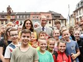 wills and kate take a photo with beaming youngsters