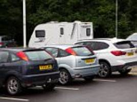 Travellers set up camp in council headquarters carpark