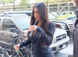 racy! kim kardashian flashes her boobs as she goes braless in sheer top