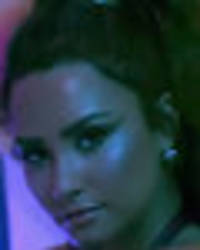 Demi Lovato's assets spill from skintight latex in soaking wet music video