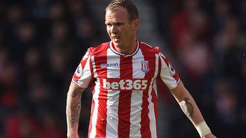 glenn whelan: aston villa sign stoke city midfielder on two-year contract