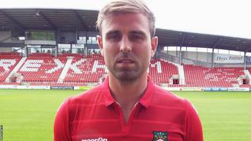 kevin roberts: wrexham sign halifax defender on two-year deal