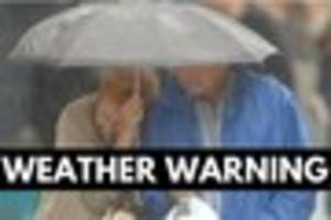 weather warning for heavy rain and high winds as summer holidays...