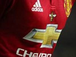 United and City wear Manchester bee symbol on shirts