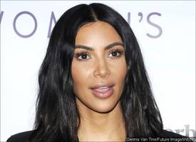 Kim Kardashian Is Basically Topless in Her Ripped Netted Outfit