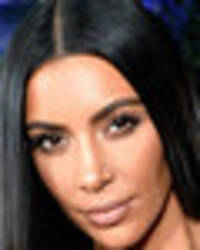 Kim Kardashian flashes everything as slashed see-through skirt upstages bulging boobs