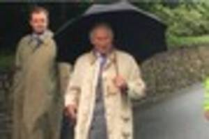 charles and camilla brave the downpours as they visit newquay and...