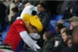 is he gunner catch him? crystal palace mascot is some way behind...
