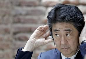 Japan's Abe courts coalition ally ahead of planned cabinet reshuffle